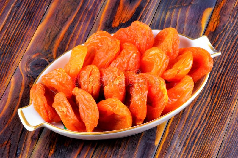 Dried apricots - dried halves of apricot fruit without seeds. Dried apricots are popular in cooking, sweet dried fruit, healthy. Food, compote making royalty free stock photo