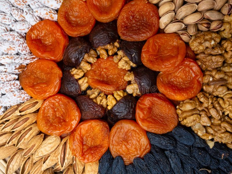 Dried apricots raisin and nuts , round composition. Circle divided into parts made of a nuts and dried apricots. Concept of royalty free stock photos