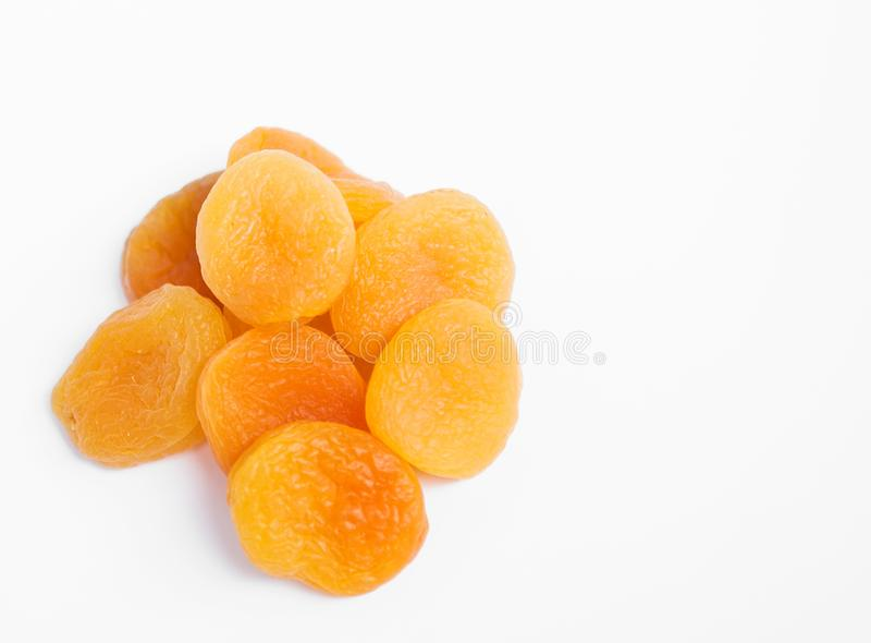 Dried apricots on white background. Dried apricots on white background with copypaste royalty free stock photography