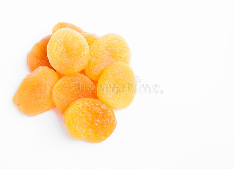 Dried apricots on white background. Dried apricots on white background with copypaste stock photo