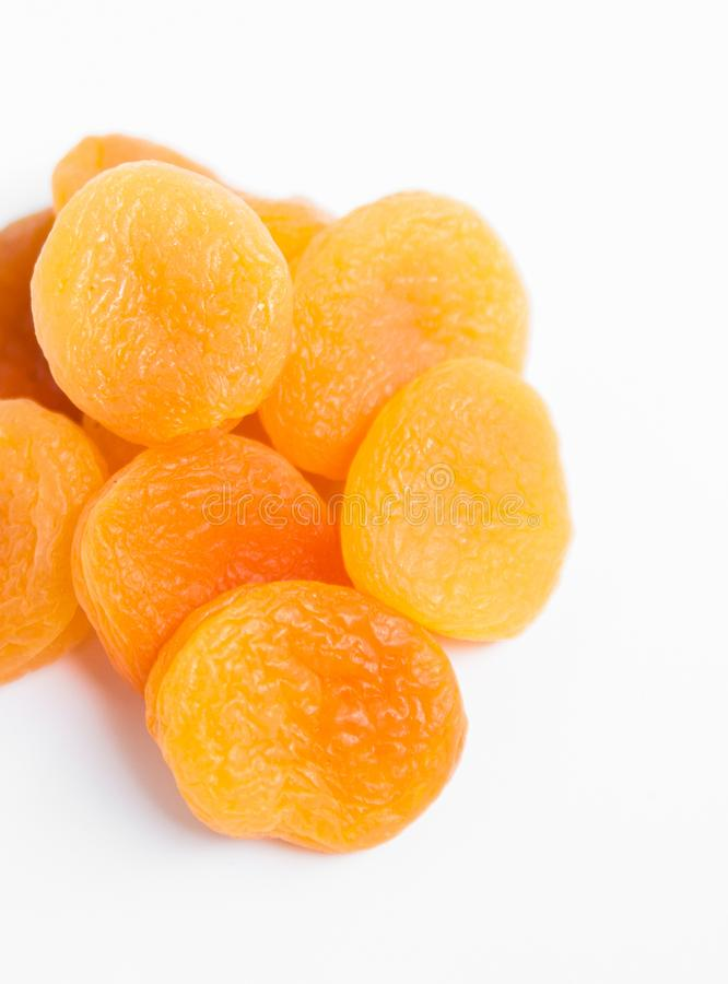 Dried apricots on white background. Dried apricots on white background with copypaste royalty free stock image