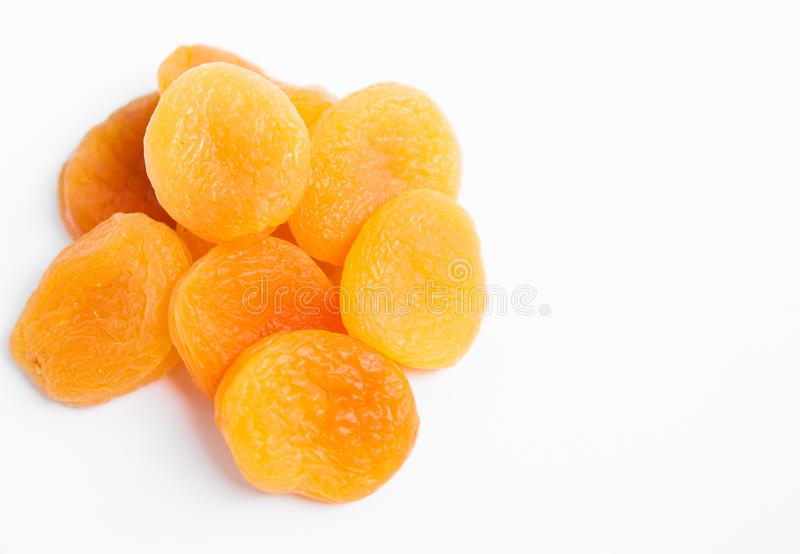 Dried apricots on white background. Dried apricots on white background with copypaste stock image
