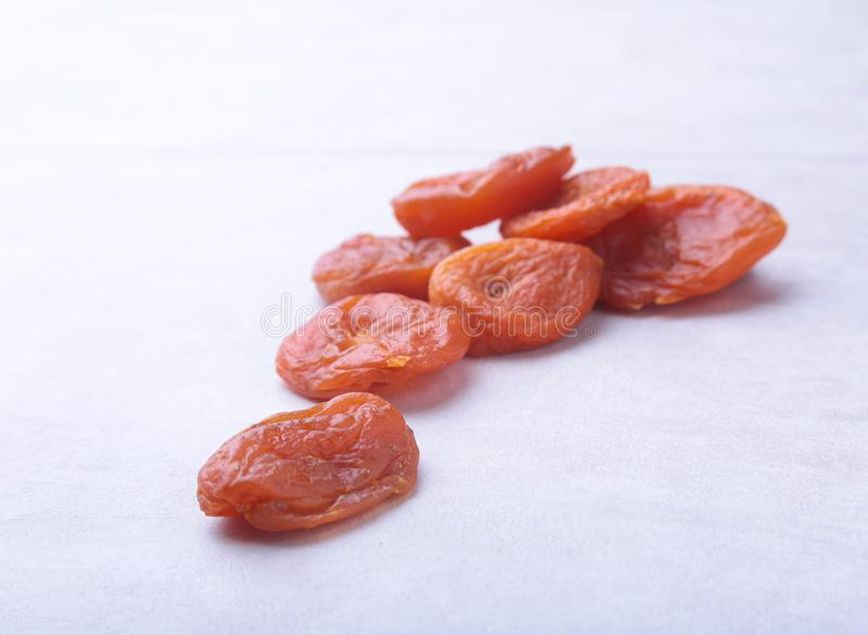 Dried apricots white background. selective focus. stock images