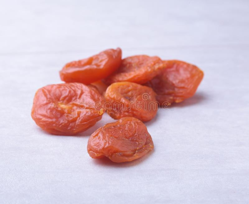 Dried apricots white background. selective focus. stock photos