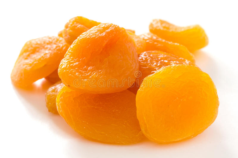 Dried apricots on white surface stock image