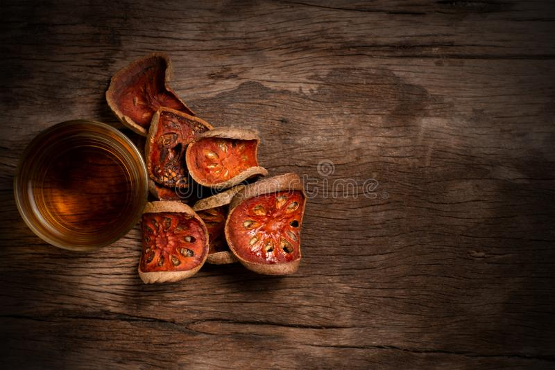 Dried bael fruit and bael juice. royalty free stock photo