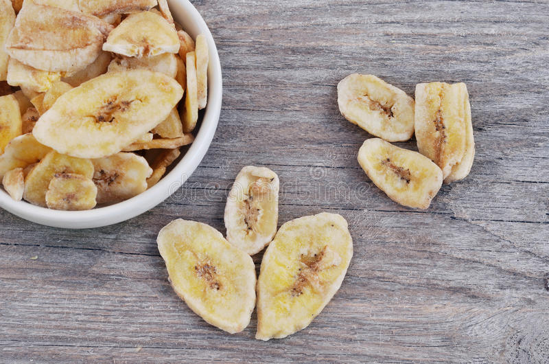 Dried bananas. On the wood backgraund royalty free stock photography