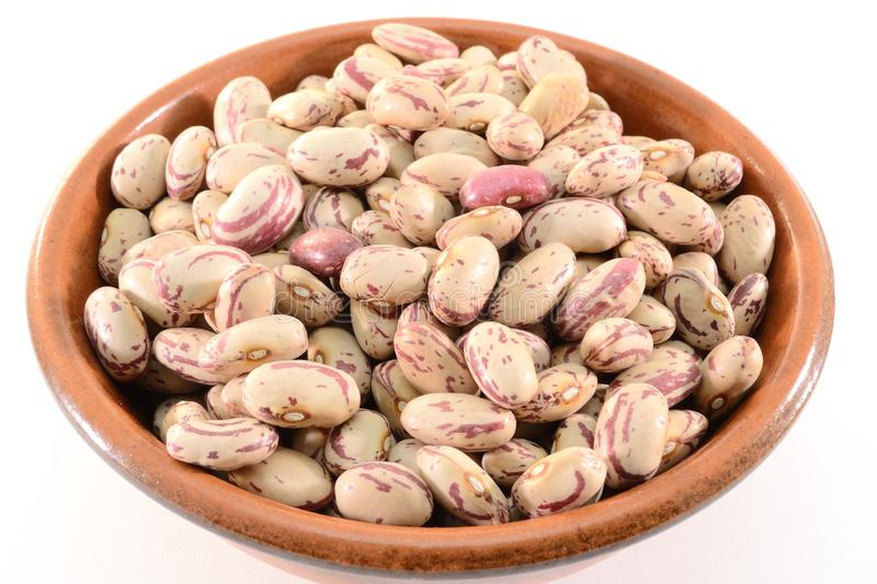 Dried beans. In a bowl isolated on white background royalty free stock photos