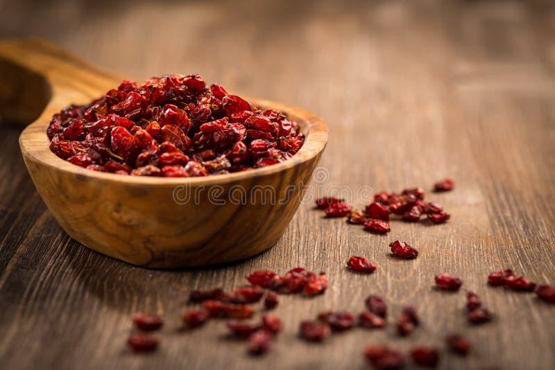 Dried berberis. Dried Barberry Berberis vulgaris on wooden table royalty free stock images