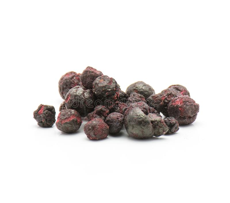 Dried bilberries. Freeze dried bilberries stack on white background royalty free stock photo