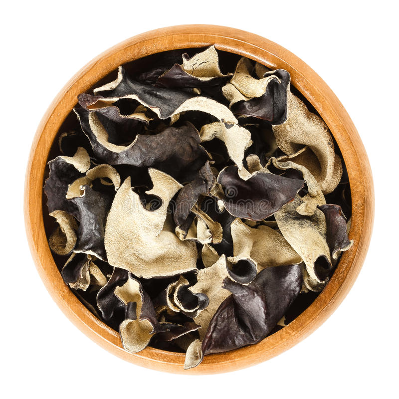 Dried black fungus Jew`s ear in wooden bowl stock photo