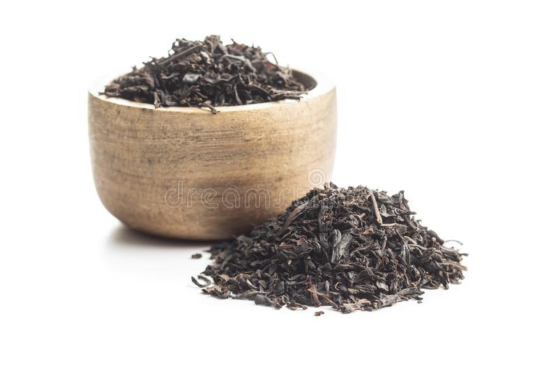 Dried black tea leaves stock photography