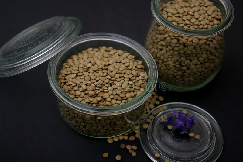 Dried browhn lentils. Some dried, brown lentils in a bowl stock image