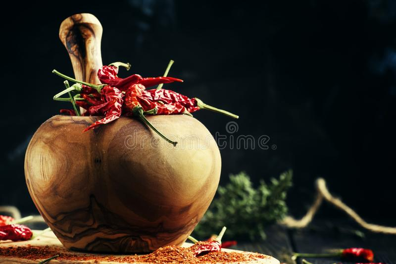 Dried chili pepper, and ground in a mortar, selective focus royalty free stock photo