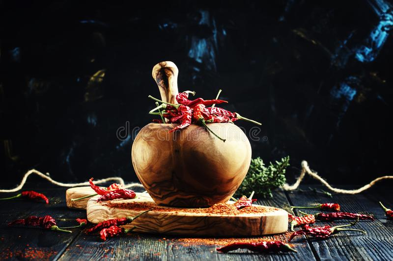 Dried chili pepper, and ground in a mortar, selective focus stock photography