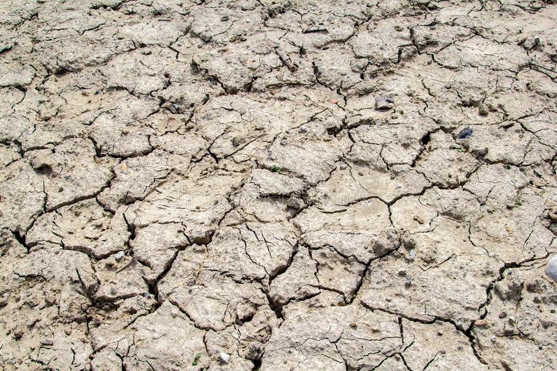 Dried and cracked earth soil from draught royalty free stock photography