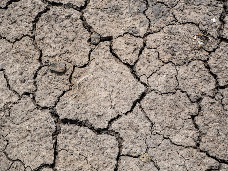 Dried cracked earth soil ground texture background.Crack soil on royalty free stock photo
