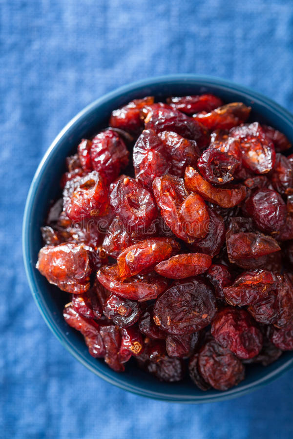 Dried cranberries in a bowl.  royalty free stock images