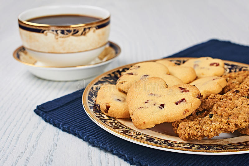 Dried-Cranberry Shortbread Hearts and Oatmeal Raisin Cookies With Coffee stock photos