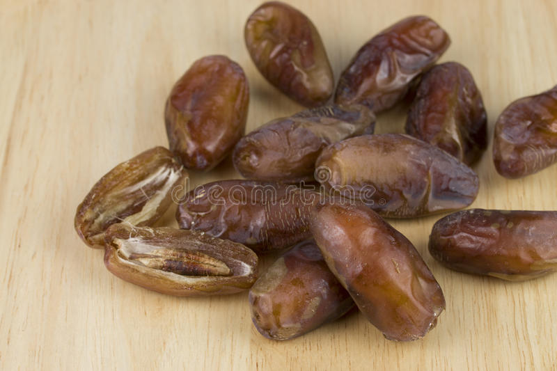 Download Dried Dates On The Wood Table Stock Photo - Image: 83709392