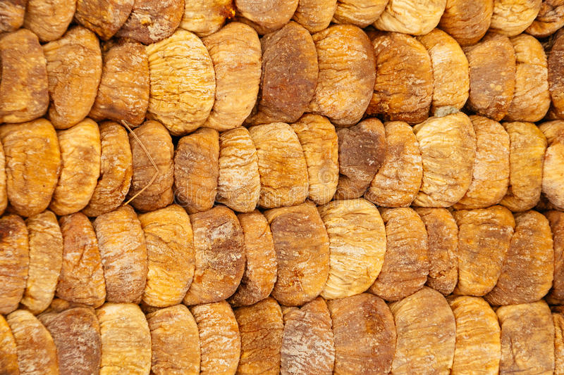 Dried figs rows and columns, vegetarian food background stock image
