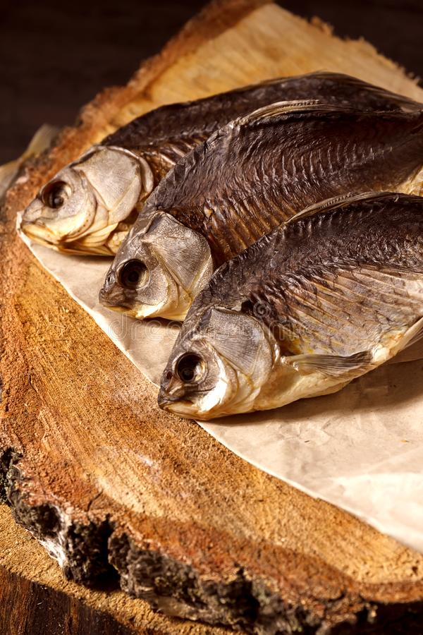 Salty dry river fish on a wooden impressive background. stock photos