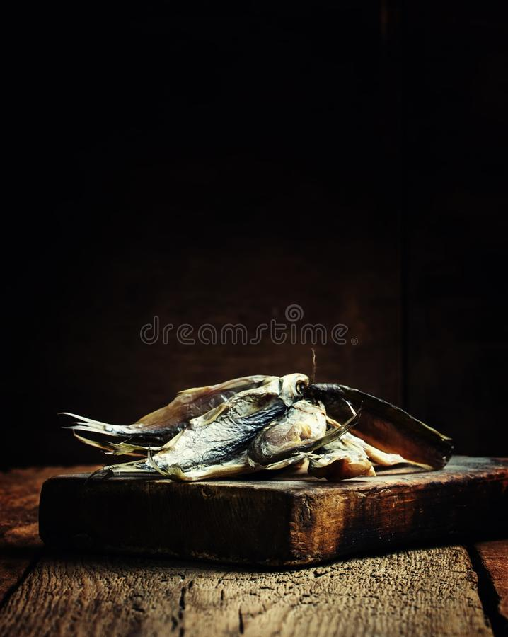 Dried fish. Vintage wooden background, selective focus stock photos