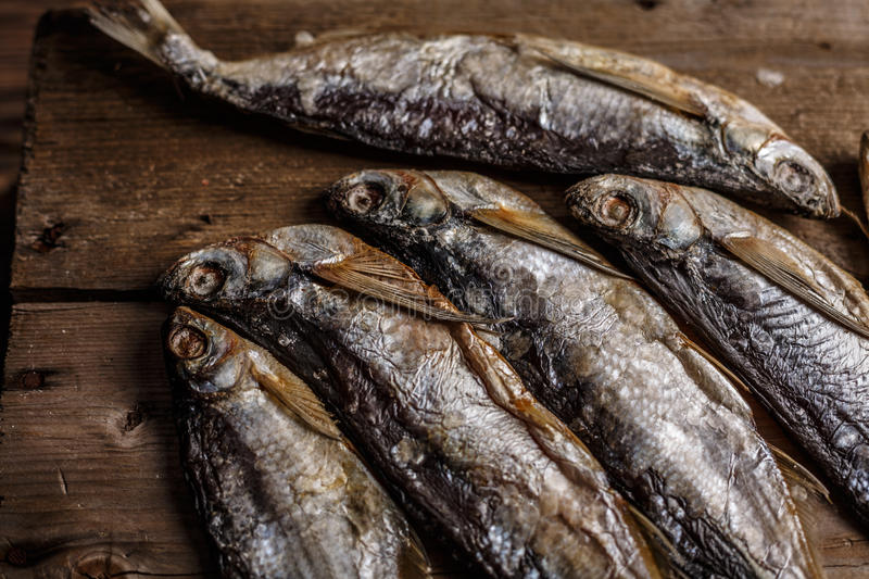 Dried fish. On wooden table. Selective focus, narrow depth of field stock photo