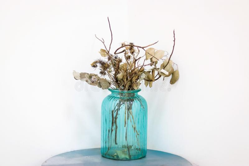 Dried flowers in the blue glass jar stock photography