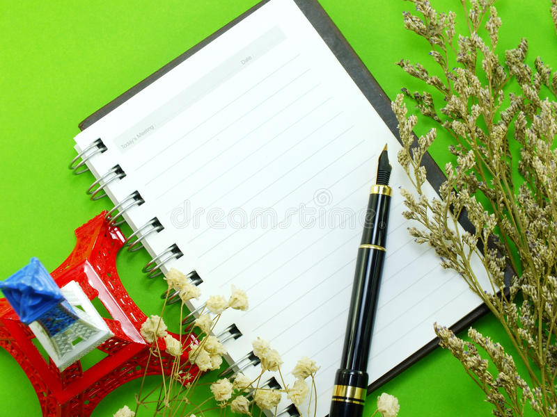 Dried flowers and empty notebook page. Dried flowers decore and empty notebook page stock photography