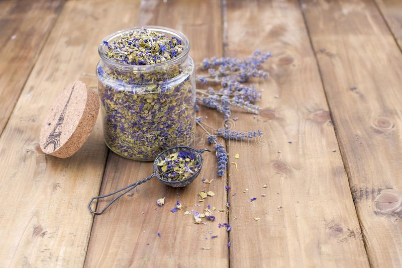 Dried flowers of lavender and mallow on a wooden background. Natural health. Aromatherapy. Free space for text. Copy space. stock image