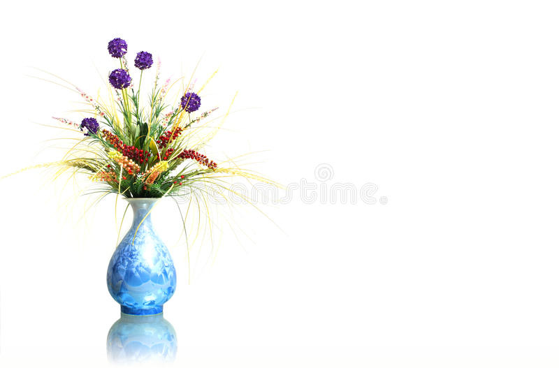 Dried flowers in vase. Isolated on white royalty free stock photo