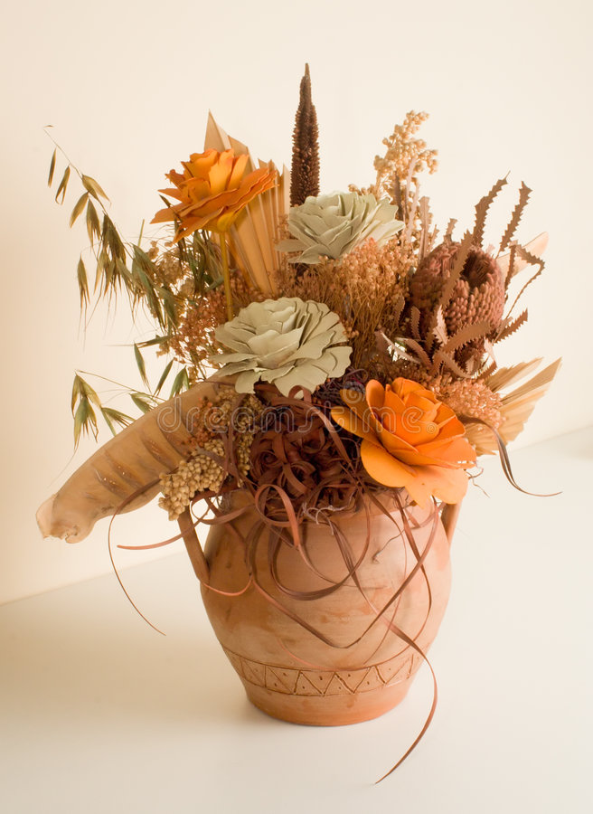 Dried flowers in vase stock images