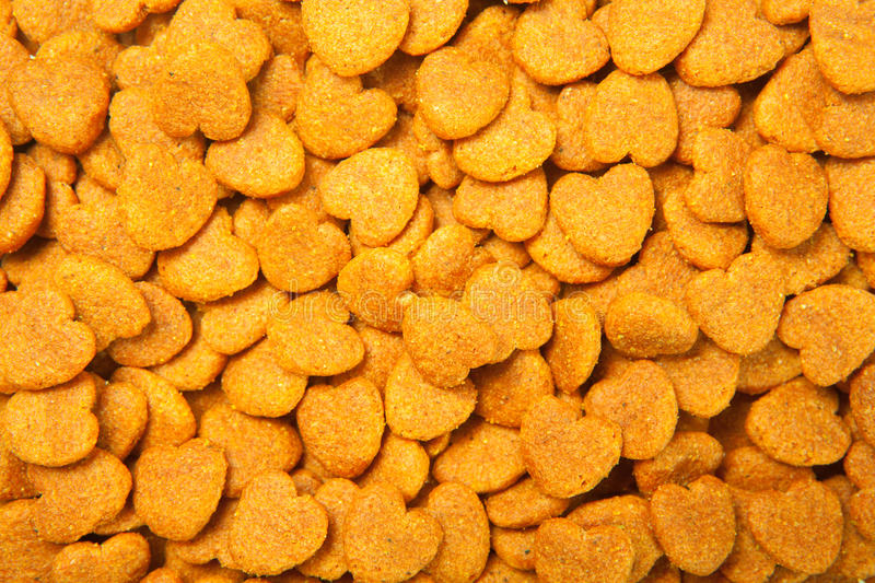 Dried food for dog puppy, heart stock photos