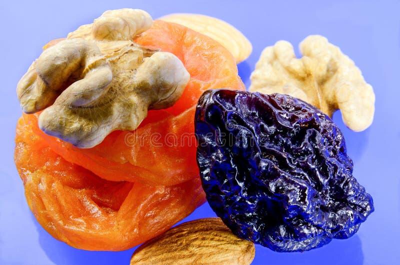 Dried fruit blue background stock image