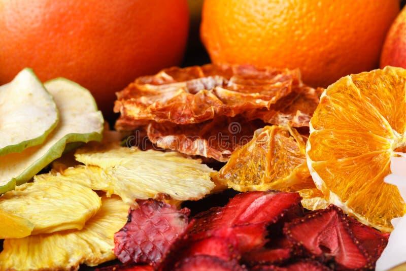 Dried fruit with juicy slices of citrus. Orange, lemon, grapefruit. Citrus mix concept. Healthy snack royalty free stock photography