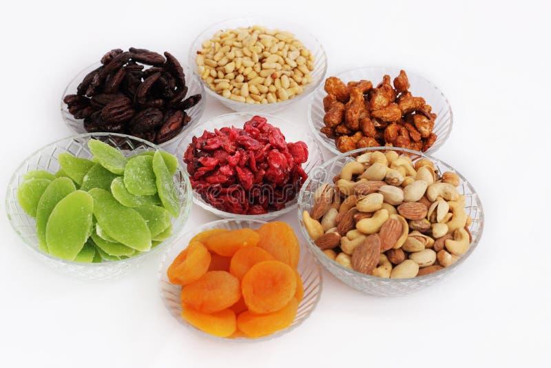 Dried fruits and almonds - symbols of judaic holiday Tu Bishvat. Dried fruits and almonds served in elegant plates - symbols of the Jewish holiday Tu Bishvat stock photo