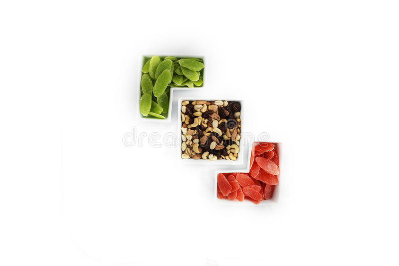Dried fruits and almonds - symbols of Jweish holiday Tu Bishvat. Dried fruits and almonds - symbols of judaic holiday Tu Bishvat. Served in plates forming an royalty free stock photos