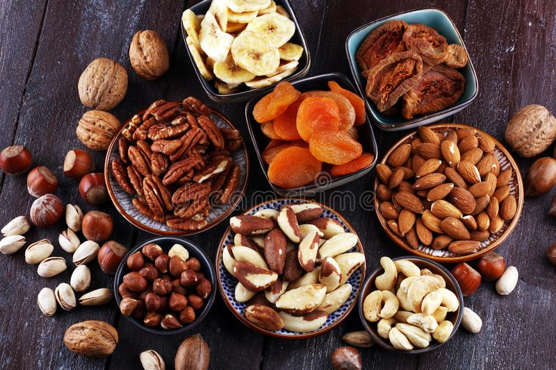 Dried fruits and assorted nuts composition on rustic table royalty free stock photos
