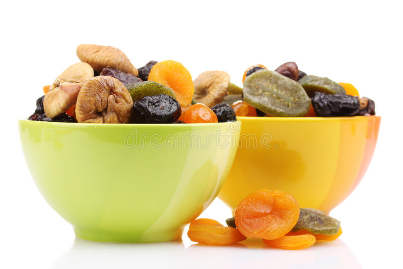 Dried fruits in bright bowls stock photo