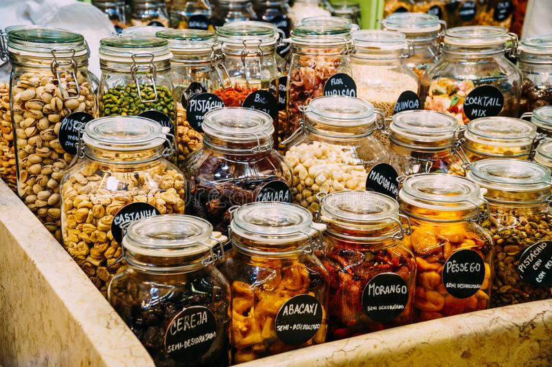 Dried Fruits In Glass Jars. For Sale In Market royalty free stock photography