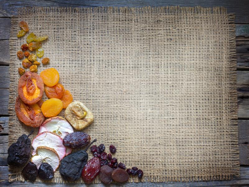 Dried fruits on jute empty background with free space. Closeup royalty free stock photos