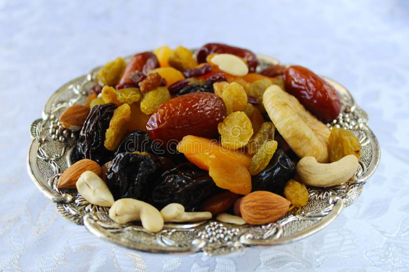 Dried fruits and nuts of Israel, mix. Dried fruits - symbol of the Jewish holiday Tu Bishvat. Figs, almonds, prunes, raisins, dates stock images