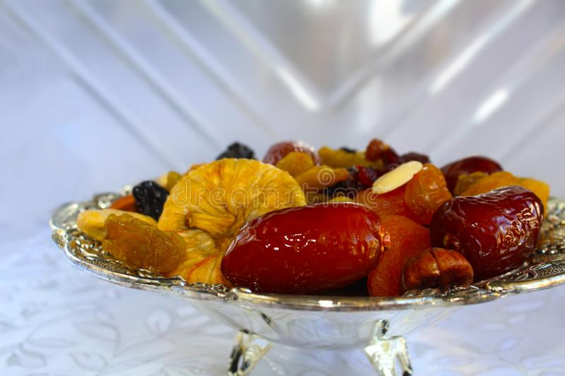 Dried fruits and nuts of Israel. Dried fruits and nuts - symbols of the Jewish holiday Tu Bishvat. Figs, almonds, prunes, raisins, dates, kashio stock images