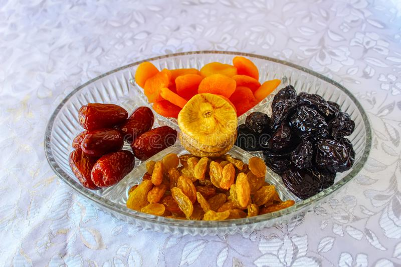 Dried fruits and Nuts on the Jewish holiday Tu Bishvat in Israel. Figs, Apricots, Prunes, Dates, Raisins, Almonds, Cranberries, Walnuts and Cashews in a glass stock photo