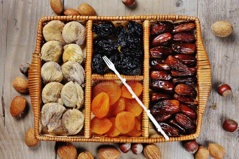 Dried fruits prunes dates apricots figs symbols of judaic holiday Tu Bishvat. In a wooden box royalty free stock images