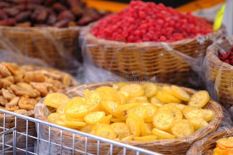 Dried fruits, street market. Quality photo of various dried fruits. You may see lots of dried fruits and berries in neat wicked baskets somewhere at street stock image