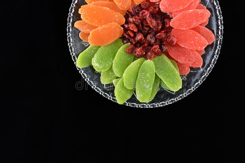 Dried fruits - symbols of Jweish holiday Tu Bishvat. Dried fruits served in plate and forming a flower shape - symbols of the Jewish holiday Tu Bishvat stock photo