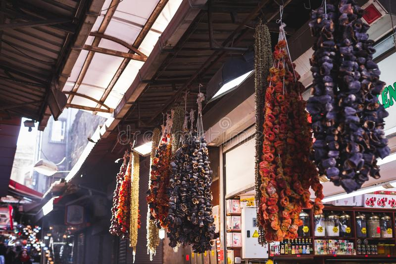 Dried fruits and vegetables hanging street market. Dried fruits and vegetables sold in the market, hanging on the counter large bundles royalty free stock photo