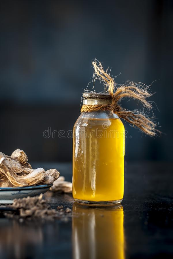 Dried ginger with oil and nutmeg powder. Dried ginger or soth or Zingiber officinale with nutmeg powder and its extracted oil for good digestion and medicine stock image